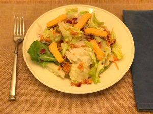 salad with chedz and bacon bits topped with chedz